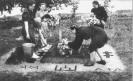 Merginos puošia partizanų kapus